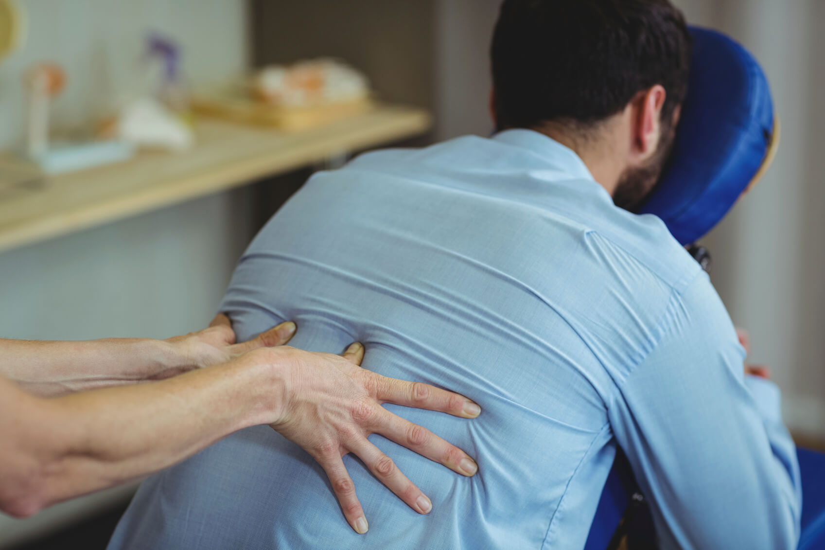 A man receiving back massage treatment following a back injury