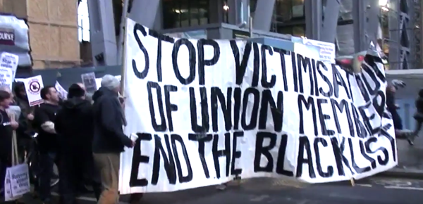 People protesting to stop victimisation of union members to end the blacklist.