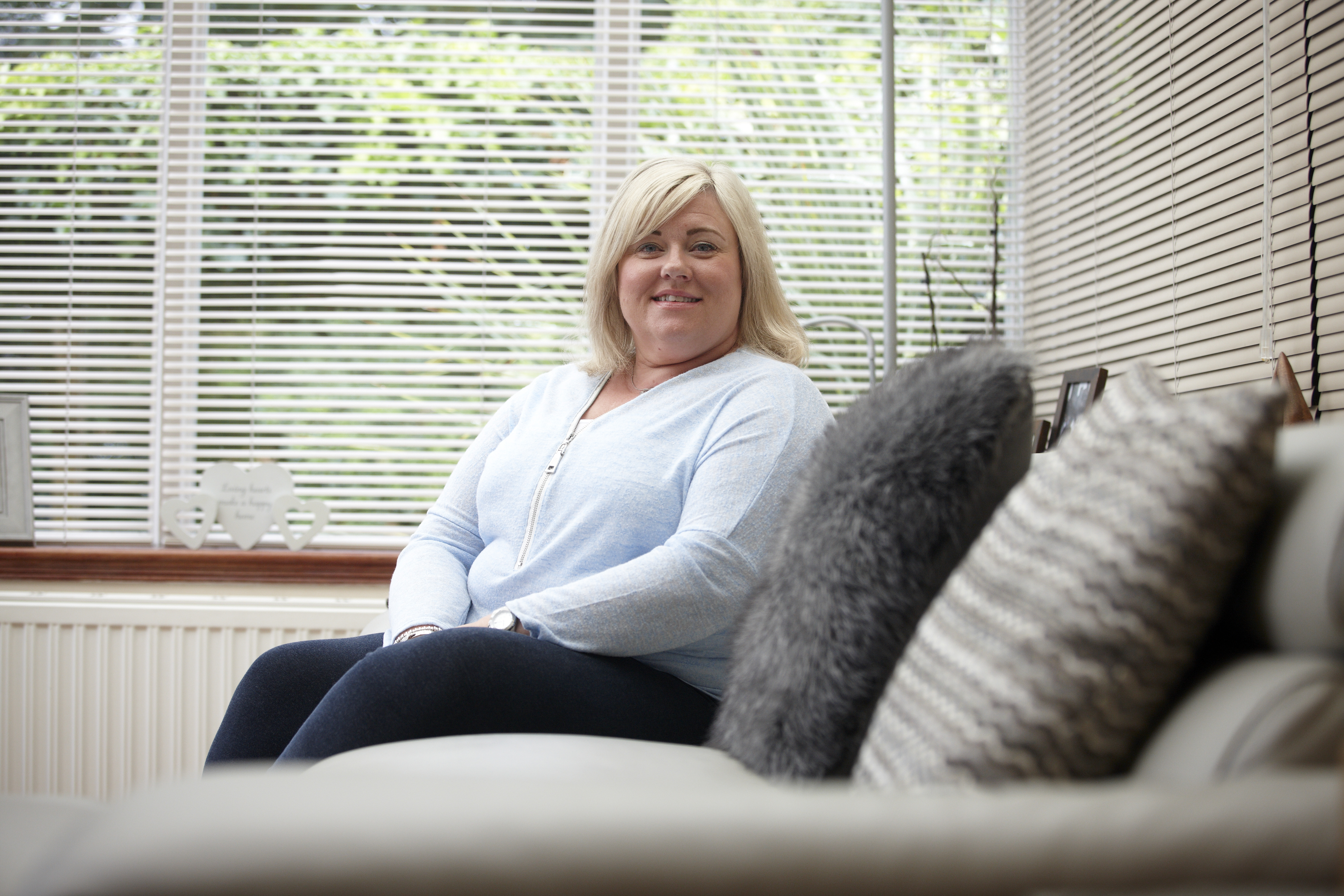 Sarah Thompson, Unite member who fought for compensation following unnecessary surgery, in her living room